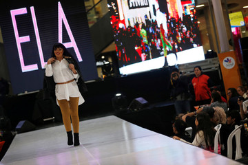 """Patricia Espitia, survivor of an acid attack, walks the runway during the fashion show """"Women who are reborn"""" in Bogota"""