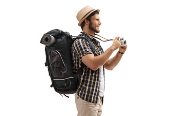 Fototapeta Young male tourist with a backpack and a camera obraz
