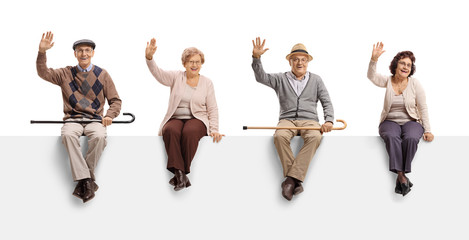 Senior with a cane sitting on a panel and waving