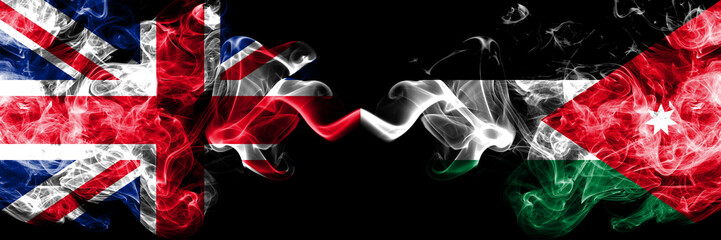United Kingdom vs Jordan, Jordanian smoky mystic flags placed side by side. Thick colored silky smoke flags of Great Britain and Jordan, Jordanian.