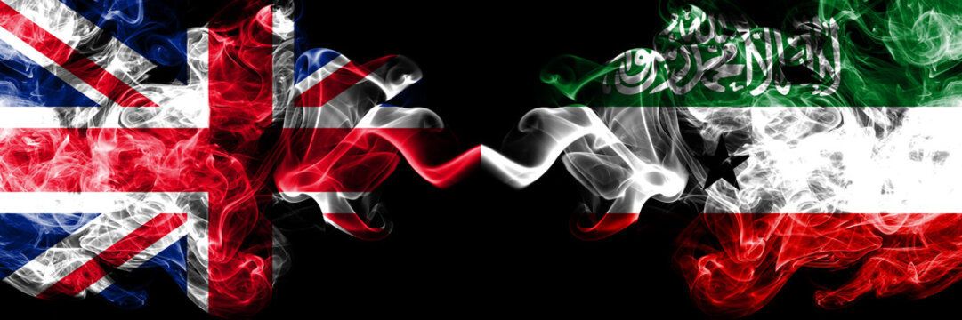 United Kingdom vs Somaliland smoky mystic flags placed side by side. Thick colored silky smoke flags of Great Britain and Somaliland.