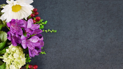 Beautiful colorful flowers bouquet on black table background texture with copy and text space, shot...