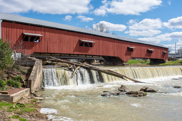 A logjam is seen under a fall near a covered bridge in Bridgeton, Indiana