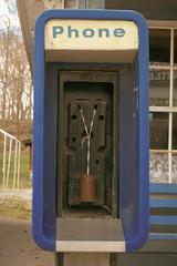 An out-of-service payphone has been equiped with older communication technology