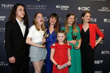 """Actresses and producers pose backstage with best motion picture award for """"A Colony"""" at the 7th annual Canadian Screen Awards in Toronto, Canada"""