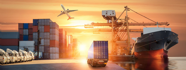 Logistics and transportation of Container Cargo ship and Cargo plane with working crane bridge in shipyard at sunrise, logistic import export and transport industry background Wall mural