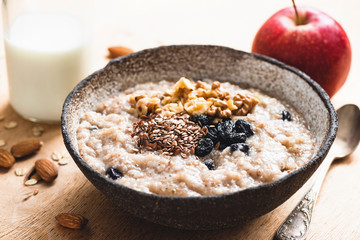 Breakfast porridge oats with seeds and raisins, closeup view. Healthy food