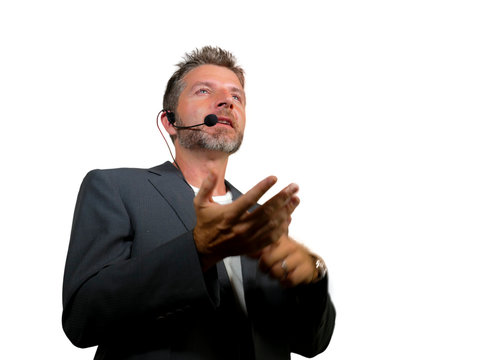 confident successful man with headset speaking at corporate business coaching and training auditorium conference room talking giving motivation training isolated