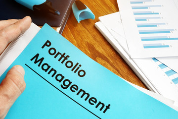 Manager is holding Portfolio Management documents. Wall mural