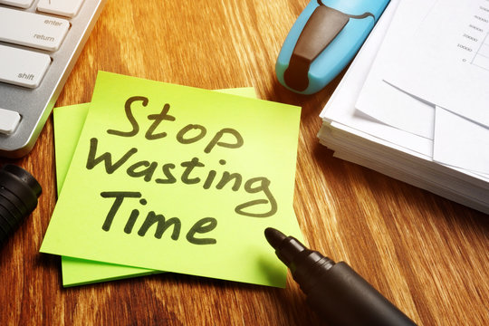 Stop wasting Time notice on a piece of paper.