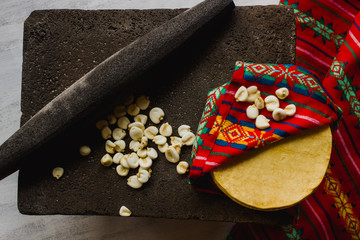 Mexican tortillas and corn on a metate. Mexico traditional culture, pre-hispanic food