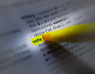 A close up of the a dictionary page showing the highlighted word: vote