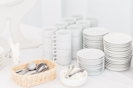 White ceramic mugs. Group of empty coffee cups. White cup for service tea or coffee in breakfast or buffet and seminar event.