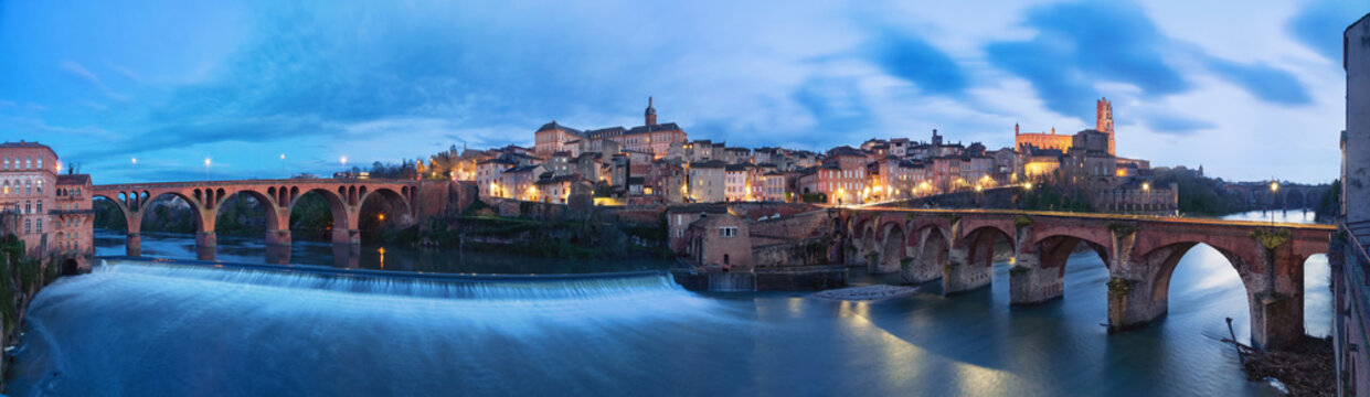 Albi, France. Panoramic cityscape at dusk made from bank of Tarn river