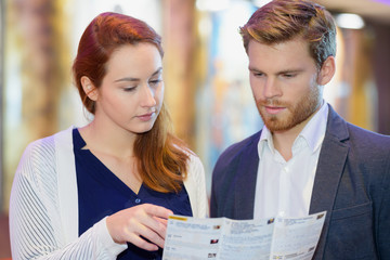 couple holding a brochure
