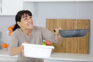 mature woman suffering water leaks at home