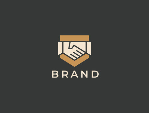 Abstract handshake business logo, vector logo. Two hands make a deal on the shield background. Trust, friendship, partnership, agreement, business, success, money, deal, contract, team, symbol icon.