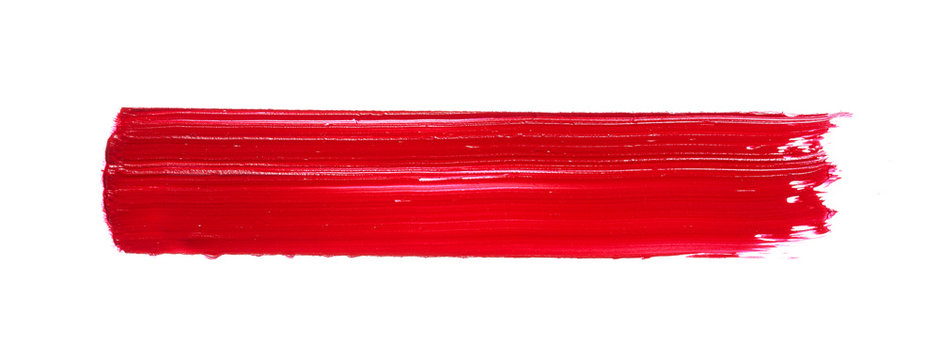 Red lipstick or acrylic paint isolated on white