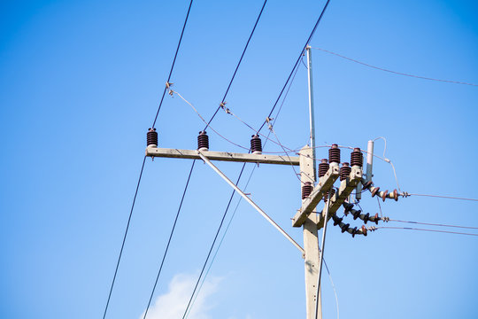 High voltage electric cables on the concrete power pole.   The joint between electric cables close up.