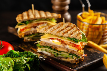 Photo sur Toile Snack Tall club sandwich and french fries