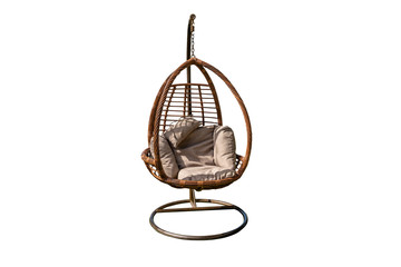 Wicker hanging chair ,swing hanging on a chain with orang cushions orange pillow isolated on white background with clipping path