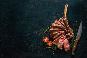 Poster de jardin Steakhouse Grilled dry aged tomahawk steak sliced as close-up