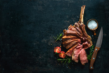 Foto auf AluDibond Steakhouse Grilled dry aged tomahawk steak sliced as close-up