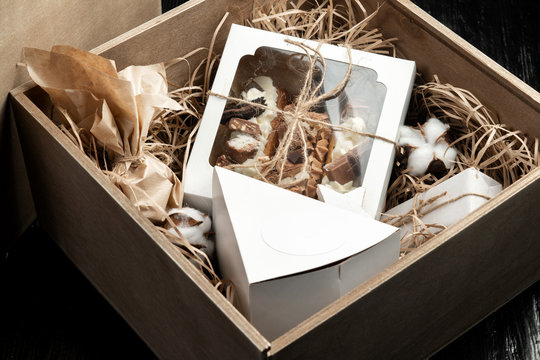 Milk chocolate with filling and cakes in a gift box tied with twine.