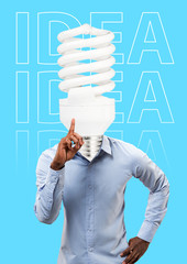 A brilliant idea. Smart brains give a light for new chances and ways. A man in shirt headed by glowing lamp standing against blue background. Business concept. Modern design. Contemporary art collage.