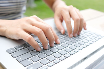 Hand of the worker He is using a computer Hands on the keyboard. Find the information on the internet at the corporate office.Technology concept