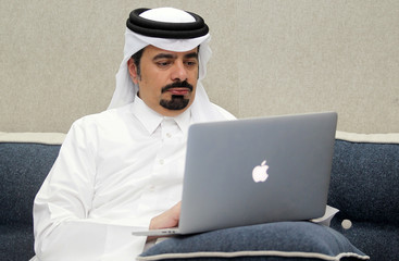 Abdullah Al Athba, editor of Al Arab newspaper poses for a photo at his home in Doha