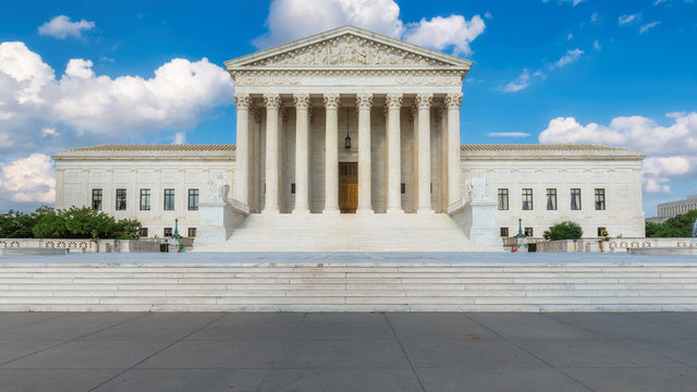 United States Supreme Court Building at summer day in Washington DC, USA.