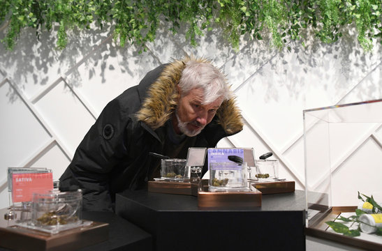 Customers and staff at the Hunny Pot Cannabis Co. retail cannabis store shop as marijuana retail sales commenced in the province of Ontario