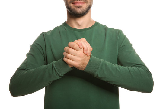 Man showing BELIEVE gesture in sign language on white background, closeup