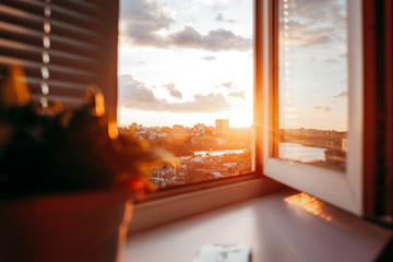 Bright evening sun in the open window