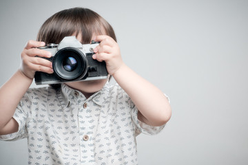 Kid with old photo camera