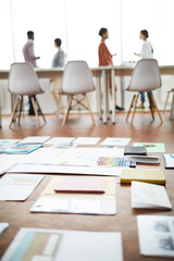 Background image of documents scattered on floor in office with contemporary design, copy space