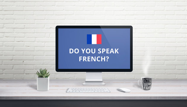 Concept of French language learning online. Question Do you speak French wih French flag on a computer display on work desk.