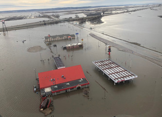 A motel, restaurant and travel stop are shown surrounded by flood waters in this aerial photo in Percival, Iowa