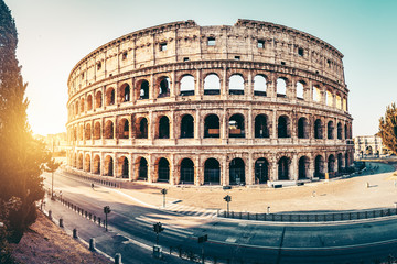 Wall Mural - The ancient Colosseum in Rome at sunset