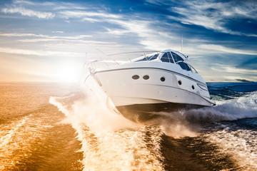 Luxurious motor boat sailing the sea at dawn Wall mural