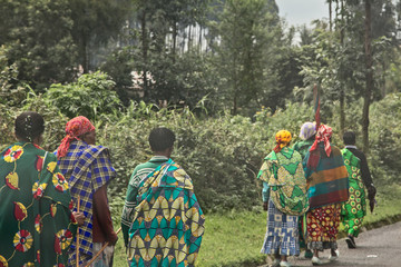 Group of rural Rwandan women in colorful traditionals clothes walking along the road, Kigali, Rwanda