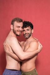 gay couple, shirtless posing in a studio, photo-shoot.