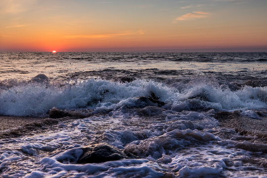 Ocean waves at sunrise in Ocean City, MD. Looking out over the Atlantic Ocean. Photo by: Chuck Beyer