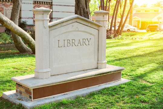 View of a stone library sign with copy space available