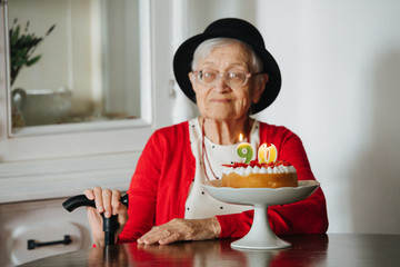 Kind grandmother is celebrating her 90th birthday at home.