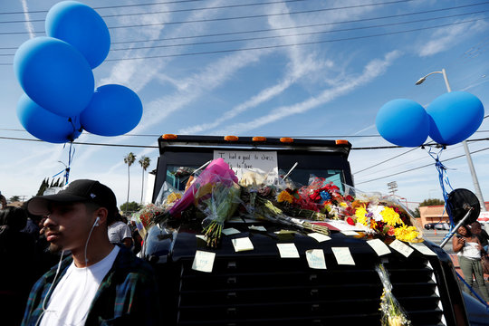 Post-it notes are pictured on a truck as a makeshift memorial for Grammy-nominated rapper Nipsey Hussle who was shot and killed outside his clothing store in Los Angeles