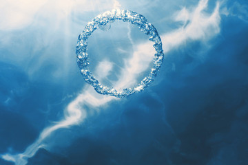 Bubble ring Underwater ascends towards the sun.