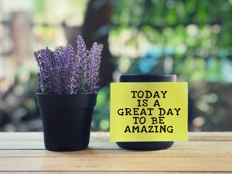 Motivational and inspirational quote - Today Is A Great Day To Be Amazing written on a yellow sticky paper. Blurred styled background.