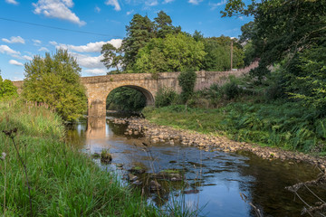 Stone bridge over the River Derwent in Blanchland, Northumberland, England, UK
